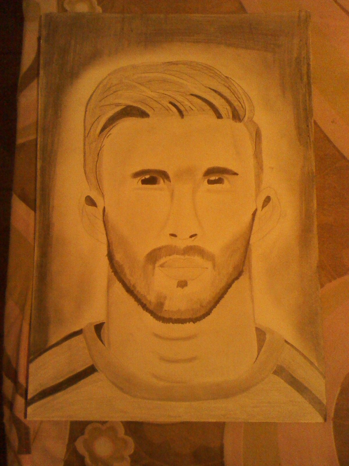 The main idea was to draw messi but then i drew it seemed more like sergio ramos so i decided better to headline it by drawing a footballer